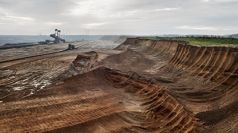A large-scale excavation with machinery at a distanceth